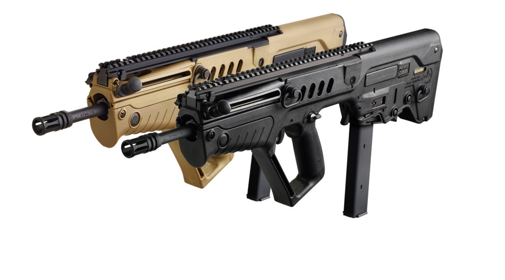 Picture of two Tavor rifles in 9x19mm. ONe of the rifles is cyote tan and the other is black.
